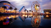 Mickey's Fun Wheel and California Screamin' attractions mirrored in Paradise Lake