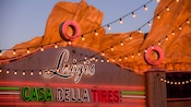 Sign for Luigi's Casa Della Tires above the attraction entrance