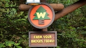Sign at Redwood Creek Challenge Trail says, Earn Your Badges Today