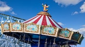 Statue of Conductor Mickey sits on top of the Silly Symphony Swings attraction