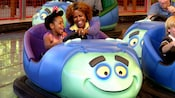 A mom and her young daughter laugh while driving a bumper car Tuck and Roll Buggy