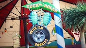 Sign: Tuck and Roll's Drive 'Em Buggies, a bug's land attraction at Disney California Adventure Park
