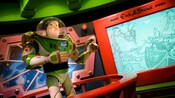 Buzz Lightyear in the briefing room gives instructions on how to play Buzz Lightyear Astro Blasters