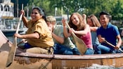 Guests smile as they paddle Davy Crockett's Explorer Canoes