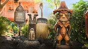 A fierce-looking Tiki statue and a Tiki standing on its head grace the attraction's enchanted garden