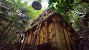 The Indiana Jones Adventure temple sits in a thick jungle in Disneyland Park