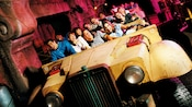 Indiana Jones Adventure Guests ride in battered military troop transport vehicles
