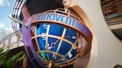 Innoventions sign circles the equator of a globe-like structure with a clock inside
