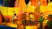 Woody and Jessie, along with 3 Native-American dolls, sing and dance in the United States scene