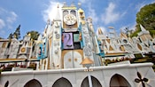 The it's a small world façade features an animated 30-foot-tall clock tower