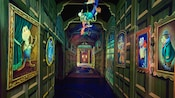 Weasels hang from the ceiling in the portrait-lined hallway inside Mr. Toad's Wild Ride attraction