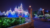 Sleeping Beauty's Winter Castle sparkles with lights and holiday decorations