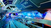 Sleek lines, designs and surfaces inside Space Mountain resemble an impressive space station