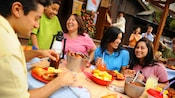 Family and friends share a meal at Big Thunder Ranch BBQ, a Disneyland restaurant
