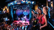 Friends enjoy a live show from the House of Blues Stage balcony
