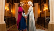 The sisters from 'Frozen' holding hands while embracing one another at Anna and Elsa's Royal Welcome