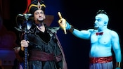 Genie holds the magic lamp to evil Jafar in Disney's Aladdin – A Musical Spectacular