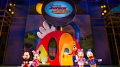 Mickey, Minnie, Goofy, Daisy, Donald perform under the Disney Junior – Live on Stage! sign