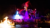 The impressive evil dragon rises from smoke during the Fantasmic! finale