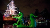 A giant alligator rises above the water in the Fantasmic! show at Disneyland Park