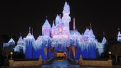 Icicles sparkle on shimmering snow-capped turrets atop Sleeping Beauty's Winter Castle