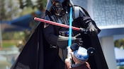 The Star Wars villain Darth Vader battles a tiny child during the final Jedi Training Academy test