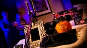 Guests are surprised by a Halloween-themed gift basket in their hotel room