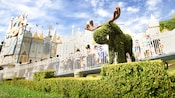 Moose topiary in front of 'it's a small world' attraction