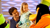 Goofy delivers the laughs to a little girl and her dad