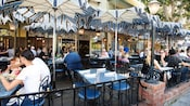 Outdoor Café Orleans tables line a small corner of New Orleans Square in Disneyland Park