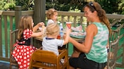 Parents and kids eat outdoors at the Hungry Bear restaurant