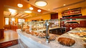 Marble counter with pastries and loaves of bread for sale at La Brea Bakery Cafe