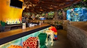 The Rainforest Cafe bar with stools painted to resemble animal legs, like dalmatian and parrot