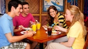 Four friends share a meal at Disney's PCH Grill, the Disney's Paradise Pier Hotel restaurant