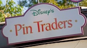 Sign for Disney's Pin Traders store above its entrance in Downtown Disney District