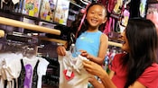 A mother and daughter shop for T-shirts at Studio Disney 365 in Downtown Disney District
