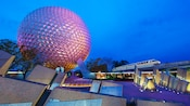 Leave a Legacy Plaza at night, with Spaceship Earth and a monorail train in the background