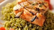 Close-up of a skewered salmon steak on a bed of herbed rice