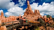 A train filled with Guests on Big Thunder Mountain Railroad