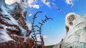 Pieces of the track twist into the sky above Expedition Everest - Legend of the Forbidden Mountain
