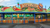The entrance and sign to TriceraTop Spin, a carnival-inspired attraction in DinoLand U.S.A.