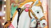 The handcrafted head of a noble steed on the Marketplace Carousel at Disney Springs