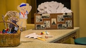 A Duffy the Bear cutout on a desk at Kidcot Fun Spot in the France Pavilion
