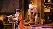 A scene on the Spaceship Earth ride depicting Johannes Gutenberg and his printing press