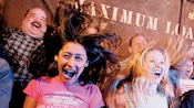 Guests scream in delight as they ride The Twilight Zone Tower of Terror attraction