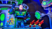 An Audio-Animatronics Buzz Lightyear waves at Buzz Lightyear's Space Ranger Spin in Tomorrowland