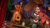 The bears Tennessee and Zeke play musical instruments at Country Bear Jamboree