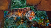 A fierce tiger bares its teeth in the dark jungle