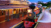 A stream-powered train waiting at Walt Disney World Railroad - Main Street, U.S.A. station at night