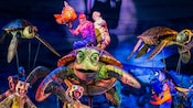Crush performing on stage at Finding Nemo – The Musical at Disney's Animal Kingdom Theme Park